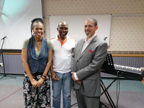 Reverend Hermy Damons with personelle